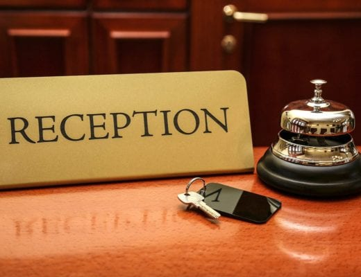 Reception name card, with service bell and room key.