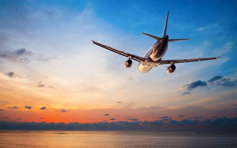 A plane mid flight, at dusk.